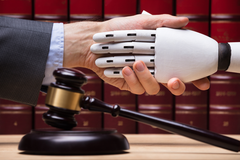 Robot representation of legal operation tool shakes hands with a lawyer.